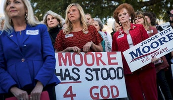 Women attend a 'Women For Moore' rally in support of Republican candidate for U.S. Senate Judge Roy Moore, in front of the Alabama State Capitol, November 17, 2017