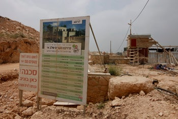 A banner detailing the contractors working on a property being built in the settlement of Leshem in 2012.