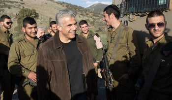 Yair Lapid, leader of Israel's Yesh Atid party, visits the country's border with Lebanon following an attack by Hezbollah that killed two Israeli Defense Forces soldiers, in 2015.