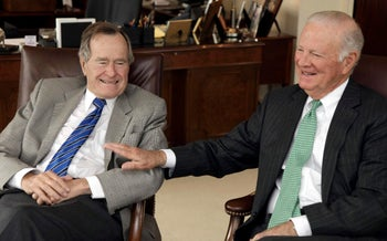 Former U.S. President George H.W. Bush, left, and former Secretary of State James A. Baker, 2011.