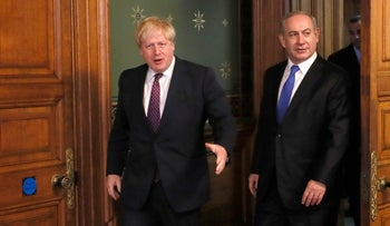 Britain's Foreign Secretary Boris Johnson, left, greets Prime Minister Benjamin Netanyahu of Israel at the Foreign Office in London, Monday, Feb. 6, 2017