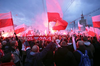Protesters in Warsaw carry Polish flags and National Radical Camp flags - an anti-Semitic group founded before World War II on extreme nationalist values -during a far-right rally to mark the 99th anniversary of Polish independence. November 11, 2017