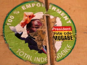 An old torn election sticker, with a portrait of Zimbabwean President Robert Mugabe, Harare, Nov. 19 2017. Zimbabwe's ruling party Central Committee begun removing Mugabe as party leader and replacing him with recently fired Vice President, Emmerson Mnangagwa