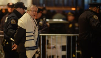 Rabbi arrested at T'ruah human rights group's pro-immigration protest at the Trump Hotel in New York City on February 6, 2017.