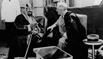 U.S. President Franklin D. Roosevelt, right, and King Abdul Aziz Ibn Saud discuss Saudi-U.S. relations aboard USS Quincy in the Great Bitter Lake north of the city of Suez, Egypt. Feb. 14, 1945