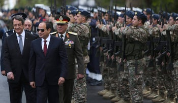 Egypt's President Abdel-Fattah el-Sissi, second from left, and Cyprus' President Nicos Anastasiades, left, review a military guard of honor following the Egyptian president's arrival at the Presidential Palace in the Cypriot capital Nicosia for an official visit Monday, Nov. 20, 2017. El-Sissi's visit aims to forge closer ties with Egypt's neighbor and comes a day ahead of the three-way meeting that will include the Greek prime minister. (AP Photo/Petros Karadjias)