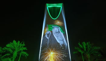 The image of King Salman and Crown Prince Mohammed bin Salman are projected on the Kingdom Tower during National Day ceremonies in Riyadh, Saudi Arabia. Sept. 24, 2017