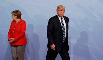 U.S. President Donald Trump walking off after being greeted by German Chancellor Angela Merkel at the G20 Summit in Hamburg, Germany, July 7, 2017.