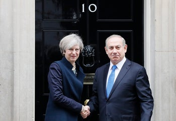Britain's Prime Minister Theresa May greets Prime Minister Benjamin Netanyahu of Israel at Downing Street in London, Monday, Feb. 6, 2017.