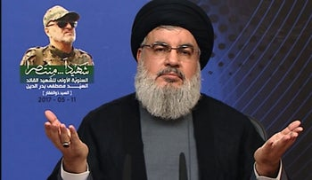 "(FILES) This file image grab taken from Hezbollah's al-Manar TV on May 11, 2017 shows Hassan Nasrallah, the head of Lebanon's militant Shiite movement Hezbollah, giving a televised address from an undisclosed location in Lebanon marking the 2016 death of Mustafa Badreddine, a key suspect in the 2005 assassination of former Lebanese prime minister Rafiq Hariri. The war of words between Saudi Arabia and Iran reflects a growing rivalry between the regional heavyweights, but experts believe the risk of a direct military clash between them is low. / AFP PHOTO / AL-MANAR TV / HO / RESTRICTED TO EDITORIAL USE - MANDATORY CREDIT ""AFP PHOTO / AL-MANAR TV"" - NO MARKETING NO ADVERTISING CAMPAIGNS - DISTRIBUTED AS A SERVICE TO CLIENTS"