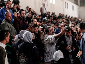 Palestinians wait to travel through the Rafah border crossing in Khan Younis, Gaza on Nov 18, 2017