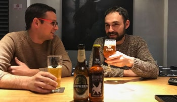 Customers sampling Palestinian- and Israeli-made beer at the Libira Brewpub in lower Haifa, in northern Israel, February 2017.