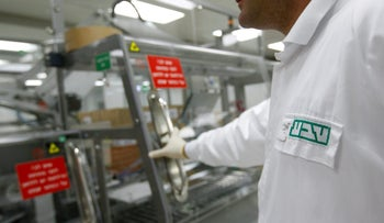 An employee of Teva Pharmaceutical Industries at the company's Jerusalem oral solid dosage plant,    December 21, 2011.