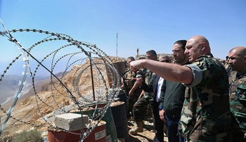 FILE PHOTO: Then-Lebanese Prime Minister Saad Hariri, third right, listens to Lebanese Army Commander Gen. Joseph Aoun, second right, during a visit to Ras Baalbek, Lebanon, Wednesday, Aug. 23, 2017.