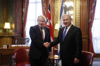 British Foreign Secretary Boris Johnson greets Benjamin Netanyahu at the Foreign Office in London, February 6, 2017.