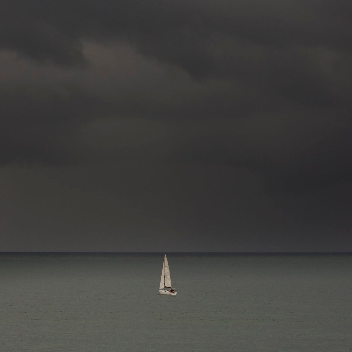 FILE PHOTO: A sailboat in the rain in Israel