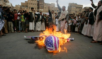 Protesters loyal to the Shi'ite al-Houthi rebel group burn an effigy of a U.S. aircraft during a demonstration to protest against what they say is U.S. interference in Yemen, including drone strikes, after their weekly Friday prayers in the Old Sanaa city April 12, 2013.