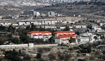 A picture taken Hebron shows a general view of the nearby Israeli settlement of Givat Harsina.