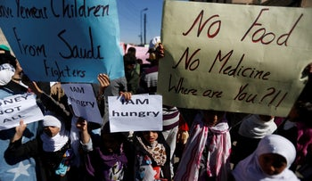 Children protest against the Saudi-led coalition outside the U.N. offices in Sanaa, Yemen November 20, 2017.