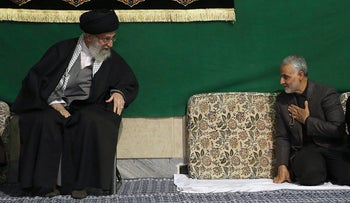 FILE - In this March 27, 2015 file photo released by the official website of the office of the Iranian supreme leader, commander of Iran's Quds Force, Qassem Soleimani, right, greets Supreme Leader Ayatollah Ali Khamenei