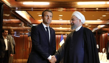 France's President Emmanuel Macron (L) meeting with his Iranian counterpart Hassan Rouhani in New York on September 19, 2017