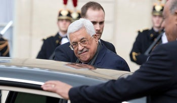 Palestinian leader Mahmoud Abbas gets into a car as he leaves the Elysee Palace after his meeting with France's President Francois Hollande, in Paris, France, Tuesday Feb. 7, 2017.