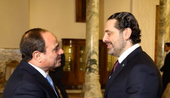 Lebanese Prime Minister Saad Hariri being greeted by Egyptian President Abdel Fattah al-Sisi  upon his arrival in Cairo,  November 21, 2017.