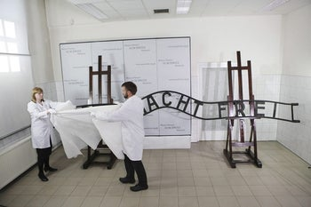 Presentation of restored sign from Auschwitz entry gate, Oswiecim, May 18, 2011.
