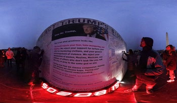 Activists write 'messages of resistance' to President Donald Trump at the grounds of the Washington Monument February 3, 2017 in Washington, DC.