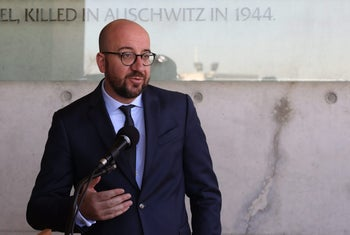 Belgian Prime Minister Charles Michel gestures as he speaks on February 7, 2017, during his visit to the Yad Vashem Holocaust Memorial museum.