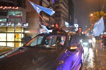 Supporters of Lebanese Prime Minister Saad Hariri wave the Future Movement flags as they celebrate his return, Beirut, Lebanon, November 21, 2017.