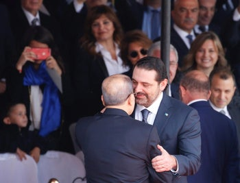 Saad Hariri greets Lebanese President Michel Aoun as he attends a military parade to celebrate the 74th anniversary of Lebanon's independence in downtown Beirut, Lebanon, November 22, 2017.