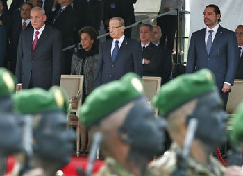 Lebanese prime minister Saad Hariri, President Michel Aoun and House Speaker Nabih Berri attend a military parade on independence day in downtown Beirut, Lebanon, November 22, 2017.