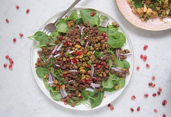 Spinach salad with spicy beef and candied pistachios.