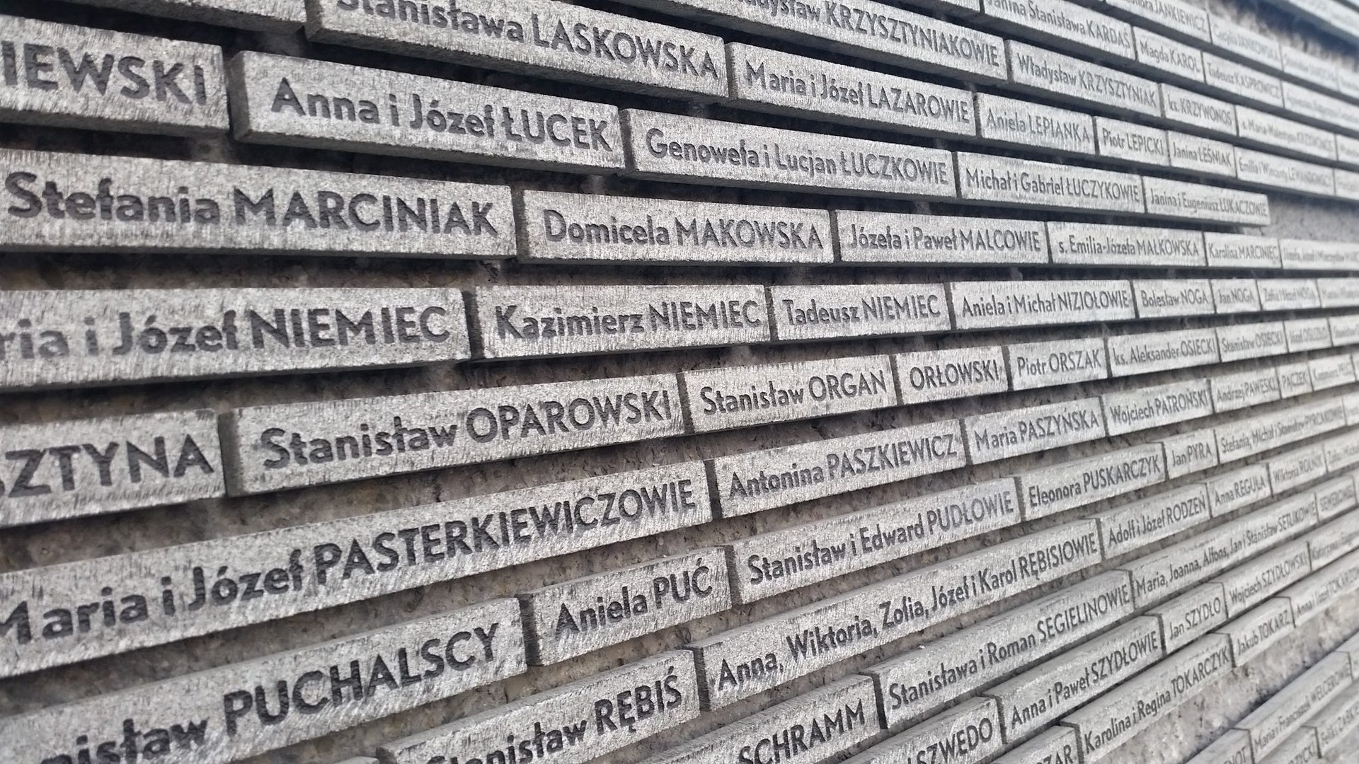 A wall commemorating poles who saved Jews during WWII in Markowa, Poland.