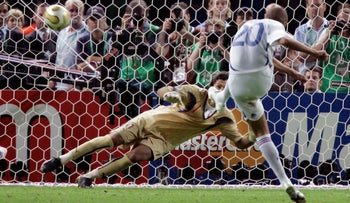 France's David Trezeguet (20) misses a penalty kick against Italy's goalkeeper Gianluigi Buffon during the penalty kick shoot out  in the final of the soccer World Cup between Italy and France in the Olympic Stadium in Berlin, Sunday, July 9, 2006.