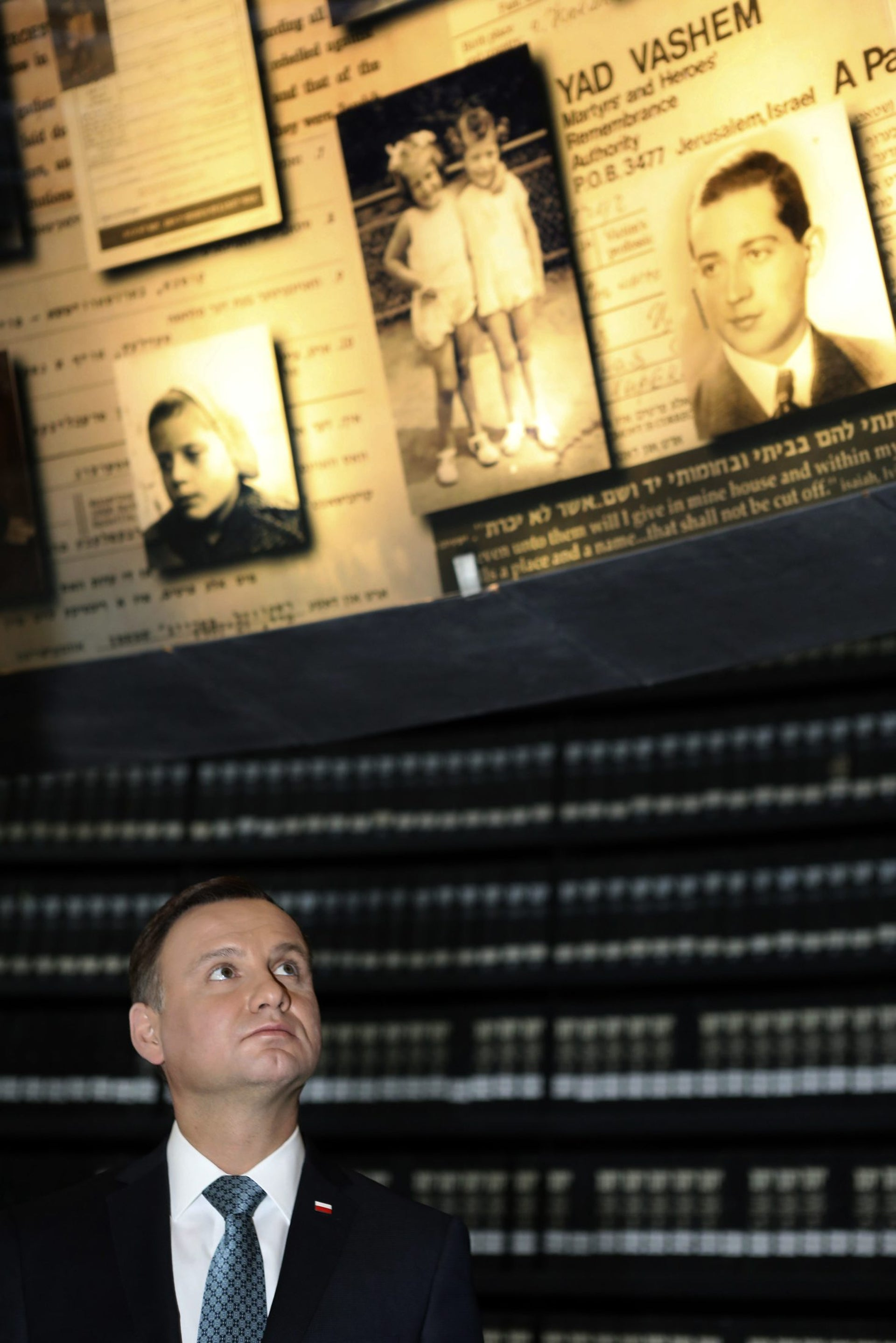 Poland's President Andrzej Duda looks at pictures of Jews killed during the Holocaust, in the Hall of Names at Yad Vashem Holocaust Museum in Jerusalem, Jan. 17, 2017.
