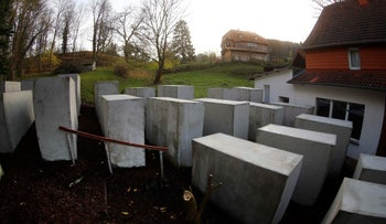 A pared-down version of Berlin's Holocaust memorial built by a German political art group seen next to the home of Bjoern Hoecke in Germany, November 22, 2017.