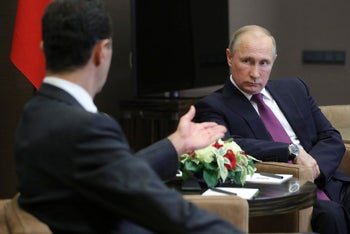 Russian President Vladimir Putinand Syrian President Bashar Assad talk during their meeting in the Bocharov Ruchei residence in Sochi, Russia on Monday, Nov. 20, 2017