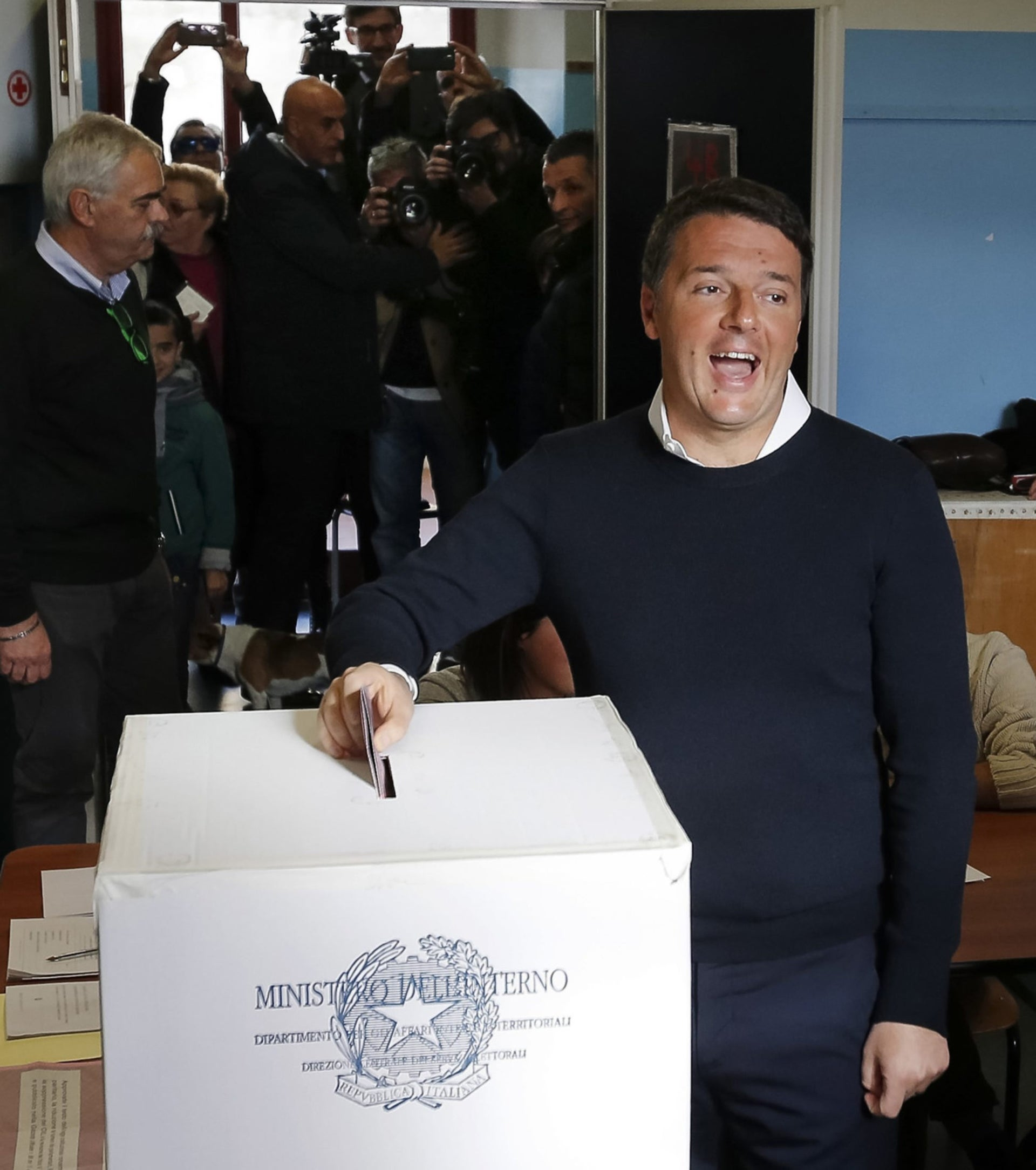Italian Premier Matteo Renzi is flanked by his wife Agnese as he casts his ballot at a polling station in Pontassieve, Italy, Sunday, Dec. 4, 2016. Italians are voting in a referendum on constitutional reforms that is being closely watched abroad to see if Italy is the next country to reject the political status quo. Premier Matteo Renzi has said he would resign if the reforms are rejected in Sunday's vote, and opposition politicians have vowed to press for a new government if voters reject the proposed constitutional changes.