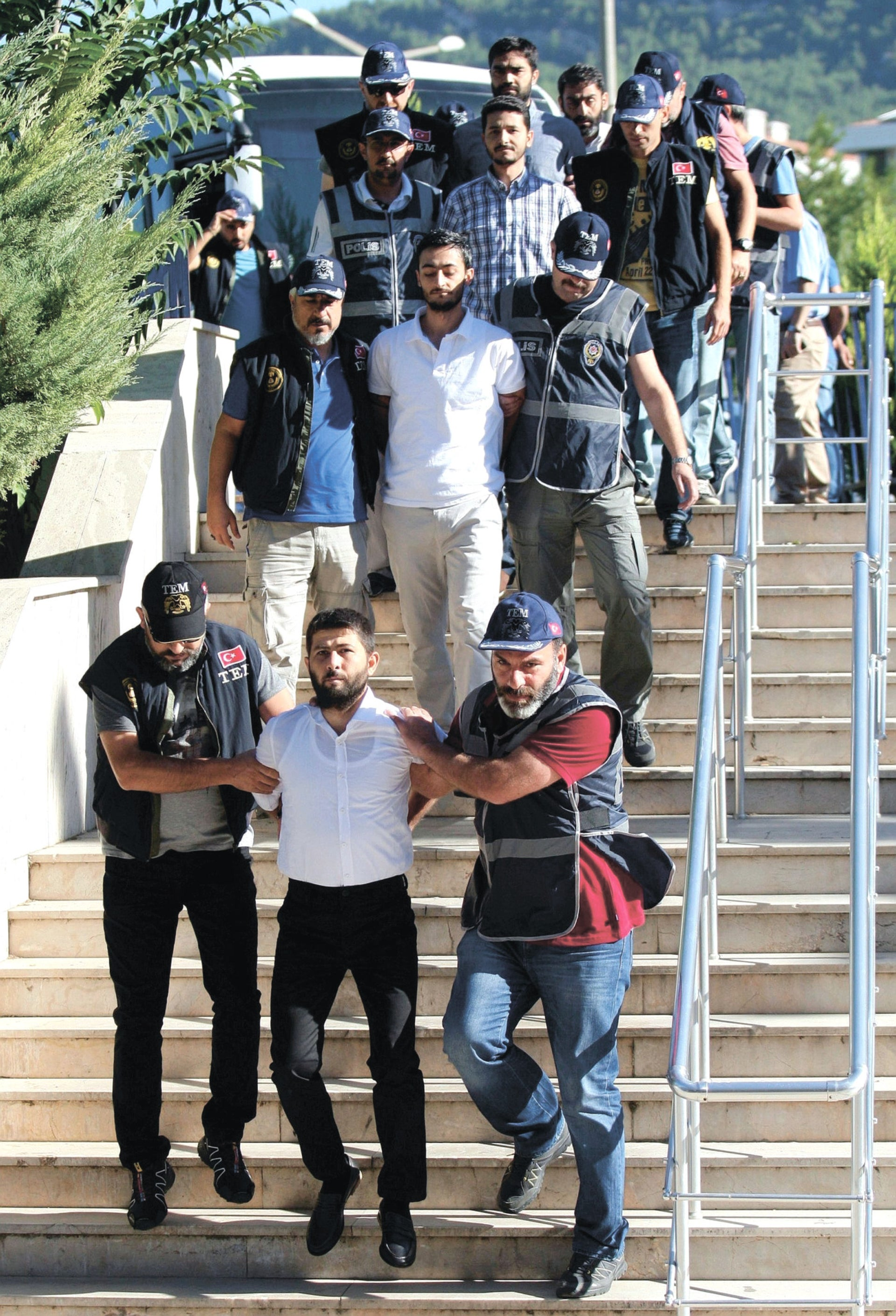 Military personnel suspected of being involved in the coup attempt, are brought to a court house as they are accompanied by police officers in Mugla, Turkey, August 17, 2016.