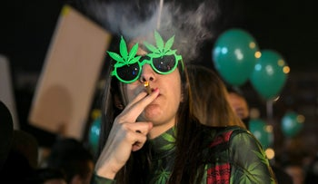A woman smokes during an event marking Israel's government's approval of a new policy to decriminalize personal marijuana use in Tel Aviv, Israel February 4, 2017.