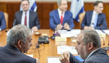 Defense Minister Avigdor Lieberman and Finance Minister Moshe Kahlon at a cabinet meeting, last year.