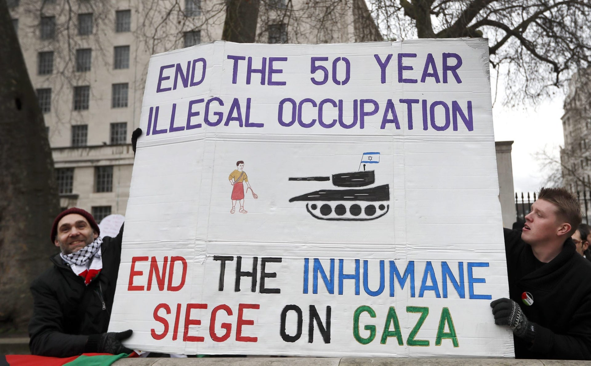 Demonstrators hold a banner calling to end the Israeli occupation, in London, during Prime Minister Benjamin Netanyahu's visit, Feb. 6, 2017.