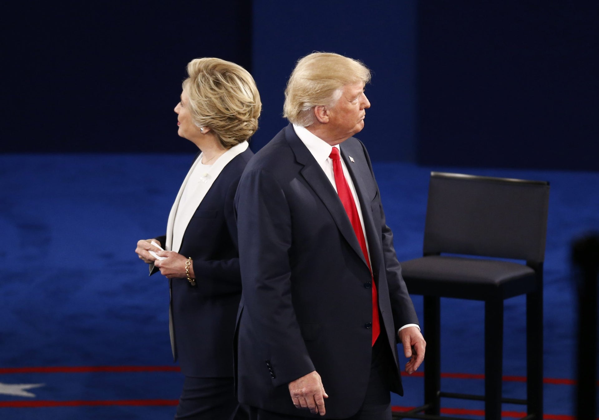 Hillary Clinton and Donald Trump on stage during the second U.S. presidential debate at Washington University in St. Louis, Missouri, Oct. 9, 2016.