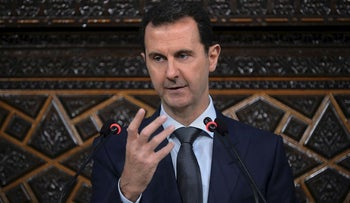 In this file photo released by the Syrian official news agency SANA, Syrian President Bashar Assad, addresses a speech to the newly-elected parliament at the parliament building, in Damascus, Syria, Tuesday, June 7, 2016