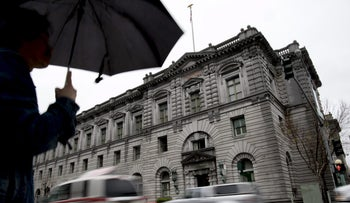 A pedestrian stands in front of the Ninth Circuit Court of Appeals Courthouse in San Francisco, California, U.S., on Wednesday, Feb. 8, 2017.