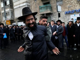 Ultra-Orthodox Jewish protester is detained by an Israeli border policeman during a demonstration against members of their community serving in the Israeli army, part of ongoing demonstrations recently seen throughout Israel, in Jerusalem February 9, 2017.