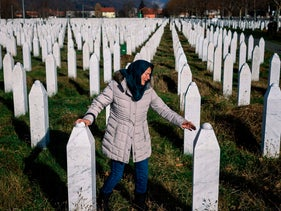 A woman mourns over a relative's grave at the memorial centre of Potocari near Srebrenica on November 22, 2017.