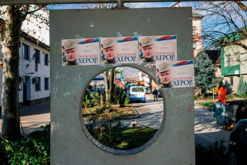 Posters depicting former Bosnian Serbian commander Ratko Mladic and reading 'You are our hero', are displayed in the town of Bratunac, on November 22, 2017.